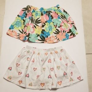 Carter's 2 skirts with shorts underneath